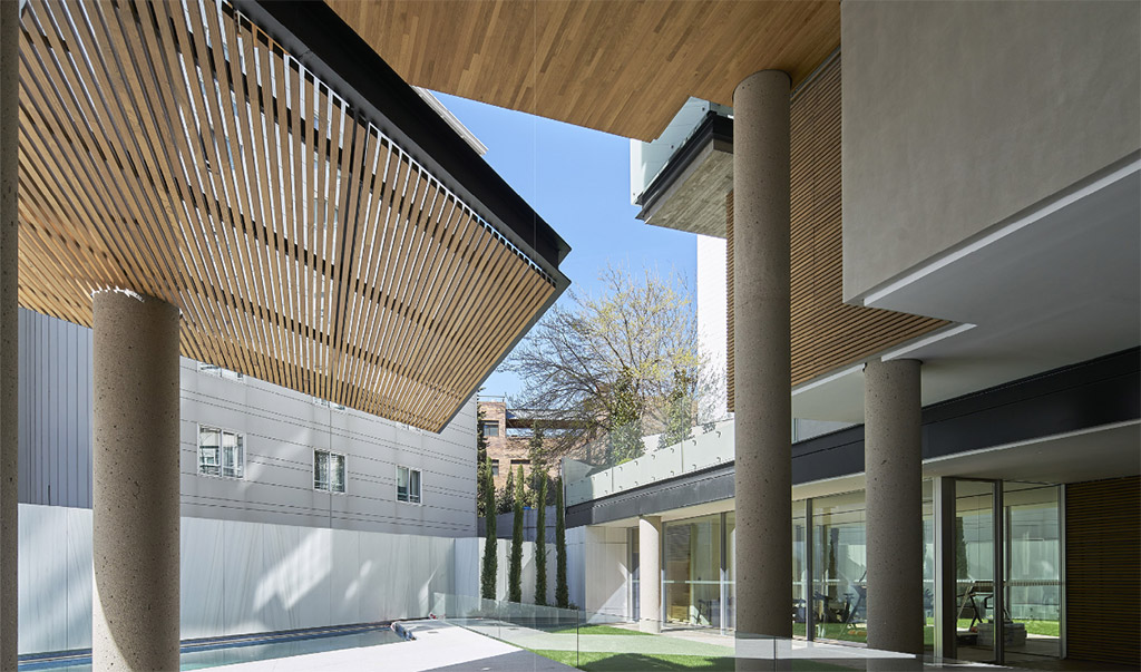 Promoción de viviendas en madrid realizadas con madera maciza para arquitectura